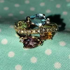 Multi colored stone gold band ring